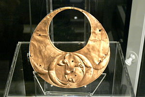 "Llyn Cerrig Bach - ""Crescentic bronze plaque"" in the shape of a gold lunula, with triskele-like decoration"