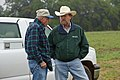 NRCS Range Management Specialist Kent Ferguson (right) discusses ranch management with an Jack County rancher Vollie Scarber. (24998760102).jpg