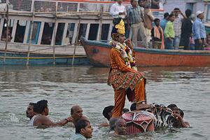Kaliya - Krishna standing on serpent Kaliya at Nag Nathaiya festival, Ganges river in Varanasi