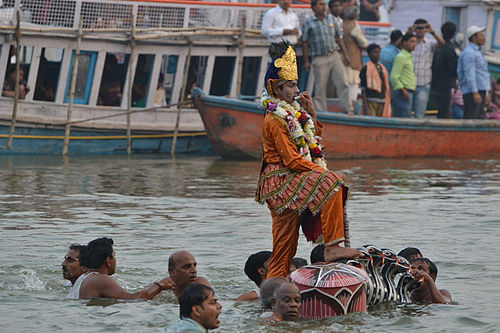 Krishna standing on serpent Kaliya during Nag Nathaiya festival in Varanasi - Varanasi