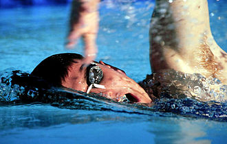 Swimming - A swimmer performing freestyle