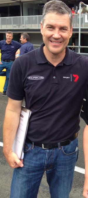 Long-time series commentator Neil Crompton at the 2014 series test day. Neil Crompton 2014.png