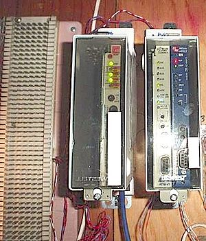 Network interface device - Three smartjacks for T-1 circuits, in two shelves; a 66 block is on the left