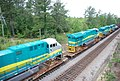 New GE locomotives transported on flat cars for export • 06.jpg