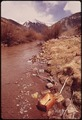 OPEN DUMP NEAR THE SAN JUAN MOUNTAINS. THE SAN MIGUEL RIVER IS POLLUTED BY THE DUMP - NARA - 543691.tif