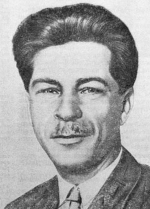 Central Committee elected by the 14th Congress of the All-Union Communist Party (Bolsheviks) - a man with wavy but well kept hair, bearded, smiling to the camera, wearing a black but stripped suit, a white shirt and a coloured tie