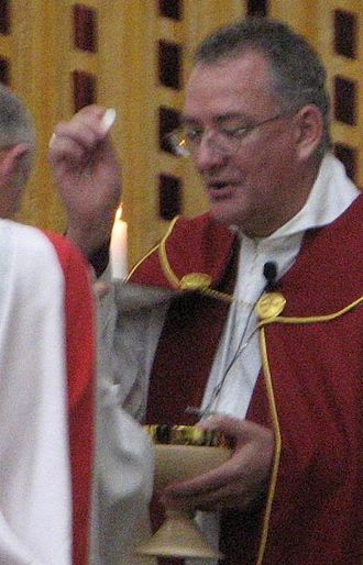 Phillip Aspinall - Aspinall administering Holy Communion