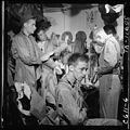 Pilots slip into flight gear aboard USS Ticonderoga (CVA-14) for strike on Manila, P.I. - NARA - 520758.jpg