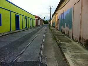 Playa (Ponce) - Deserted street in harbor warehouse area with defunct street rail line of Playa
