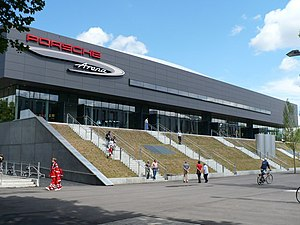 The front of the Porsche Arena next to the Carl Benz Center