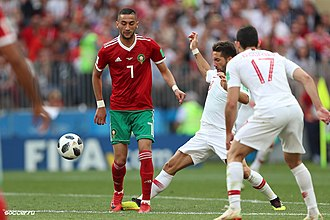 Offensive playmaker Hakim Ziyech (shirt number 7) - pictured with Morocco - playing against Portugal at the 2018 FIFA World Cup. Portugal-Morocco by soccer.ru 8.jpg