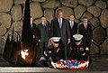 President George W. Bush bows his head as Marines lay a wreath on behalf of the United States of America.jpg