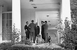 President Kennedy with advisors after EXCOMM meeting, 29 October 1962.jpg