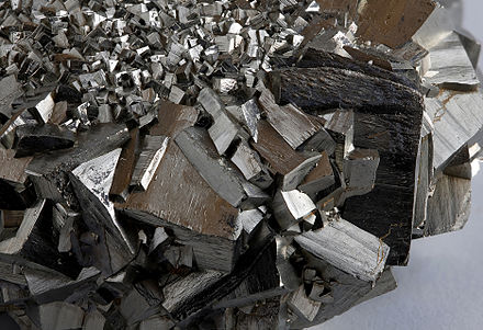 Pyrite has a metallic lustre. Pyrite 2.jpg