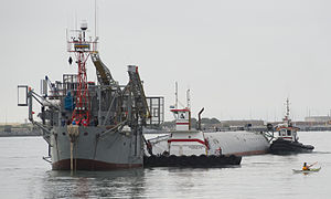 RP FLIP - Tugs move FLIP from her berth