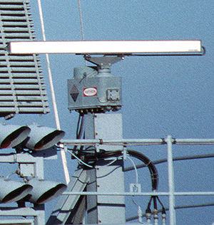 Super high frequency - X-band (8 - 12 GHz) marine radar antenna on a ship. The rotating bar sweeps a vertical fan-shaped beam of microwaves around the water surface to the horizon, detecting nearby ships and other obstructions