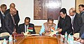 Radha Mohan Singh and the Minister of Business Enterprise and Cooperatives of Mauritius, Shri S. Bholah signing an MoU between India and Mauritius for cooperation in the field of cooperatives & allied sectors.jpg