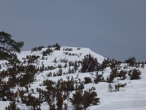Tossal dels Tres Reis - View of the mountaintop covered with snow