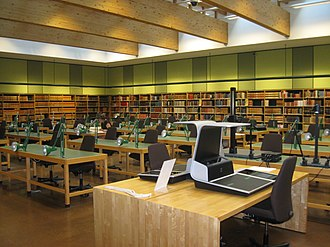 Archival research - Reading room of the National Archives of Norway. In the foreground are overhead scanners. Since archival materials are unique, some archives may have equipment available for users to duplicate materials.