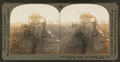 Reclaiming swamp land. Digging ditch with tractor, and laying drain tile, Wisconsin, by Keystone View Company.png