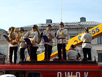 Aalto University - The Retuperä WBK is a student band that parodies a volunteer fire brigade brass band. In this picture Retuperä is performing in central Helsinki on top of their fire truck.