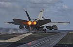 Right rear view of VF-32 FA-18F Super Hornet launching from USS Dwight D. Eisenhower (CVN-69) 160406-N-OR652-247.jpg