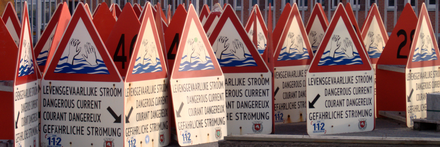 Some man-made signs warning of rip currents. Rip current warning signs.png