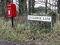 Road sign and post box - geograph.org.uk - 353183.jpg