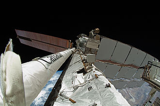 STS-134 - The newly attached OBSS at the Space Station.