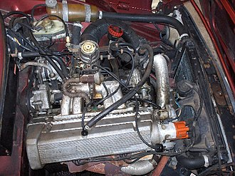 Exhaust gas recirculation - EGR valve the top of box on top of the inlet manifold of a Saab H engine in a 1987 Saab 90