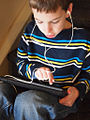 School boy with an iPad (6660035203).jpg