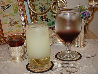 Sharbat - Two kinds of Iranian sharbat (center and right) along with Iranian tea (left)