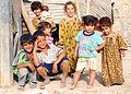Small Iraqis with big smiles greet MND-B CG as he patrols area DVIDS111846.jpg