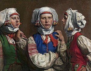 Three women in folk costumes
