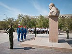 Soyuz MS-06 backup crew at the statue of Sergey Korolev.jpg