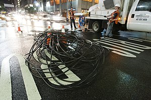 Optical fiber - Fiber crew installing a 432-count fiber cable underneath the streets of Midtown Manhattan, New York City