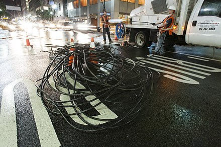 Stealth installing a 432-count dark fiber cable underneath the streets of Midtown Manhattan, New York City Stealth Fiber Crew installing fiber cable underneath the streets of Manhattan.jpg