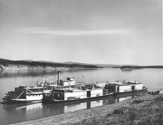 Wrigley, Northwest Territories - The S.S. Mackenzie River and three barges tied up at Fort Wrigley in 1946