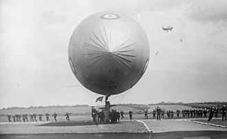 SS class airship - An SS airship lands after a patrol, showing the large crew required for handling on the ground. Another SS airship can be seen in the air.