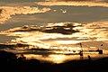 Sunset with crane in Oslo (9879674695).jpg