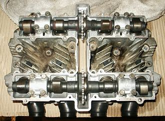 Overhead camshaft - Overhead view of Suzuki GS550 cylinder head showing double camshafts and chain-drive sprockets.