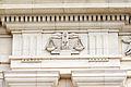 Symboles de la Justice ornant la frise du premier étage, palais du parlement de Bretagne, Rennes, France.jpg