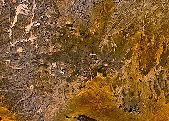 Satellite image of the volcanic field on Tarso Toh, which includes 150 cinder cones, two maars, and several basalt lava channels Tarso Toh.jpg