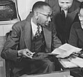 Ted Poston, New York Post journalist Ted Poston working at the Office of War Information with his assistants William Clark and Harriette Easterlin (cropped).jpg