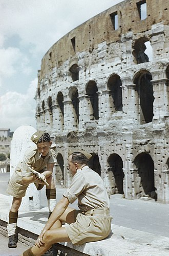 Colosseum - Allied troops consult a guidebook outside the Colosseum after liberation in 1944