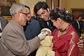 The President, Shri Pranab Mukherjee administering the Polio Drops to a child at the launch of the Pulse Polio Programme, at Rashtrapati Bhavan, in New Delhi on January 17, 2015.jpg