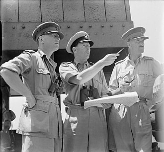 Sidney Kirkman - Left to right: Brigadier R. H. Senior, Captain P. S. Smith and Major General S. C. Kirkman on the bridge and watching the early stages of the invasion of Sicily on board the troop transport WINCHESTER CASTLE, July 1943.