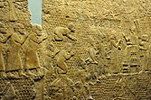 Relief depicting Sennacherib at Lachish, interacting with officials and reviewing prisoners