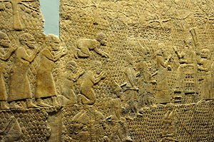 Siege of Lachish - The fall of Lachish, King Sennacherib reviews Judaean prisoners.