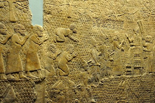 The fall of Lachish, King Sennacherib reviews Judaean prisoners.